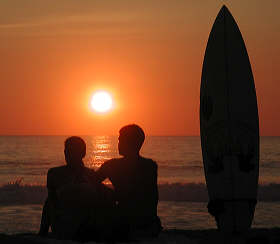 Puerto Escondido sunset surfers